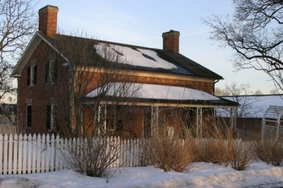 Farm house in the snow.